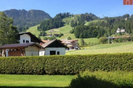 Real Estate in 6370  Kitzbühel: AT THE FOOT OF THE HAHNENKAMM: Elegant luxury apartment with 361 square meter private garden and spacious terraces - Picture
